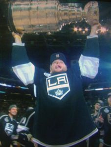 Woodstock's Jake Muzzin hoists the Stanley Cup Monday night after the Los Angeles Kings beat the New Jersey Devils 6-1 to win the series